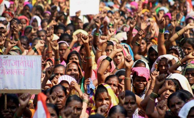 Shramjivi Sanghatana activists stage a massive protest against the cancellation of 46,000 ration...