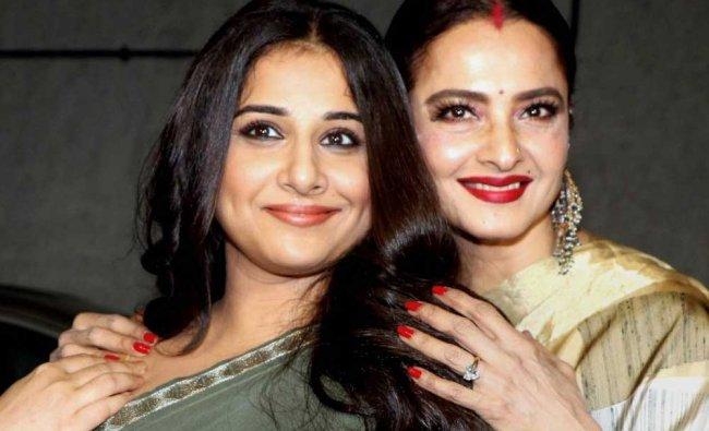 Bollywood actress Rekha (L) and Vidya Balan attend the special screening of the comedy-drama ...