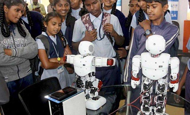 Students having a view of robots displayed at a stall at \