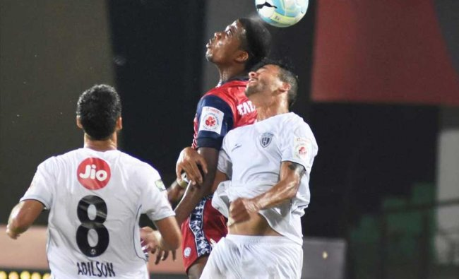 Players of North East United FC and Jamshedpur FC vie for the ball...