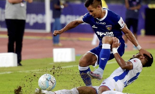Players of Chennaiyin FC and FC Goa vie for the ball during an ISL match...