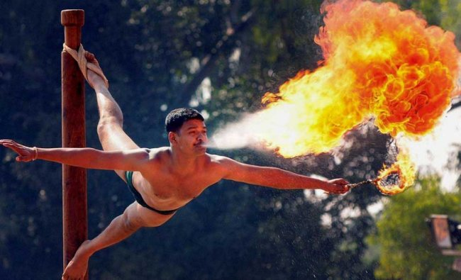 An army jawan performs a fire stunt during a \'Know Your Army\' programme...