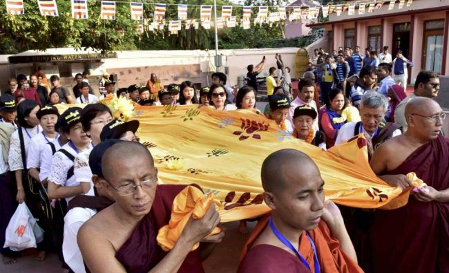 Devotees from Mymnmar going to offer huge robe to Lord Buddha at Bodhgaya Mahabodhi temple...