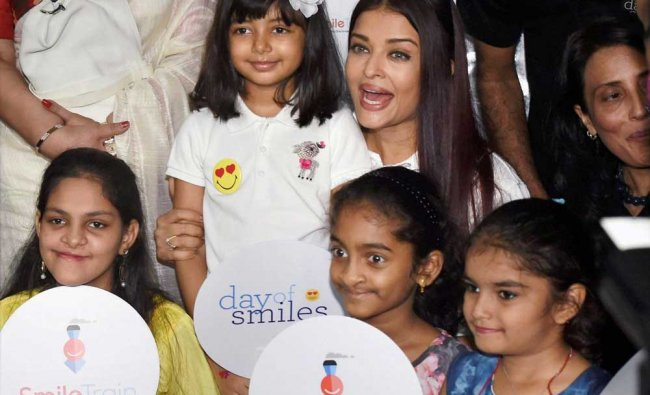 Aishwarya Rai Bachchan with her daughter Aaradhya during a charity event...