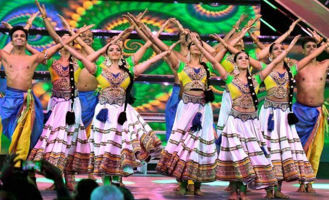Artists perform a folk dance during the inaugural ceremony of 48th edition of the IFFI...