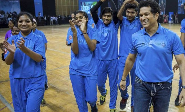 Sachin Tendulkar plays a game with Special Olympics children during a UNICEF event...