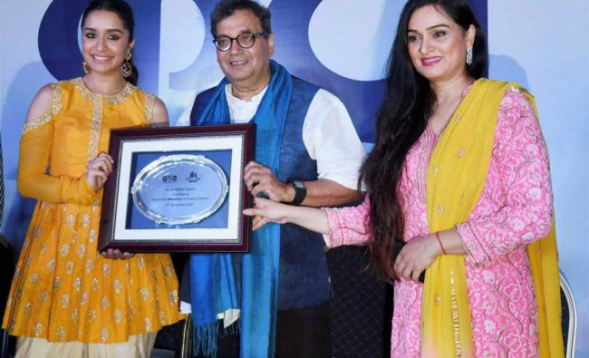Shraddha Kapoor being felicitated by Film maker Subhash Ghai as the youth icon during IFFI...