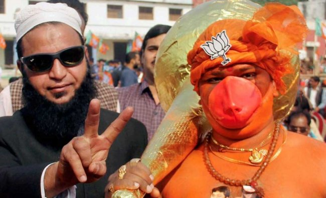 A BJP worker dressed up Lord Hanuman along with a Muslim party worker takes part in a campaign...