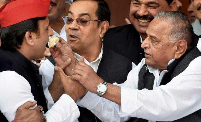 Mulayam Singh offers cake to his son Akhilesh Yadav during his 79th birthday celebrations....