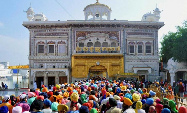 Sikh devotees paying obeisance at the Golden Temple on the martyrdom day of Guru Tegh Bahadur...