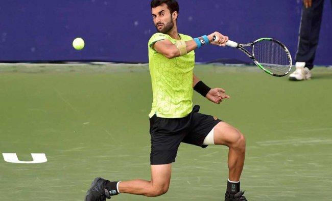 Yuki Bhambri of India plays against compatriot Prajnesh Gunneswaran...