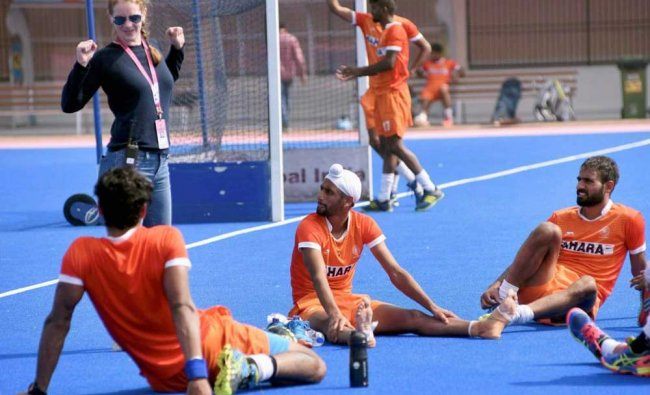 Hockey prayers during their first practice session at the Kalinga stadium...