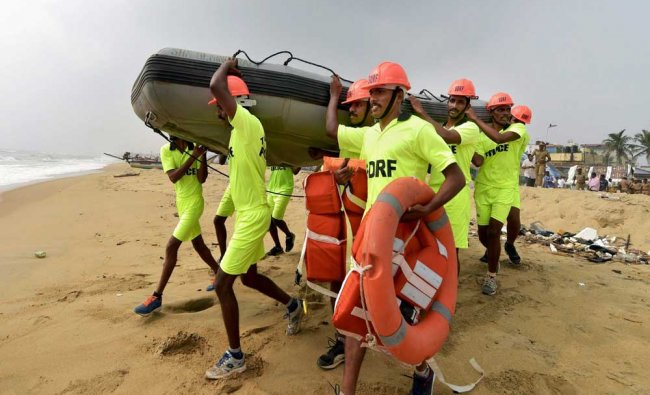 Members of the NDRF and officials conducting a tsunami mock drill in Puducherry on Friday...