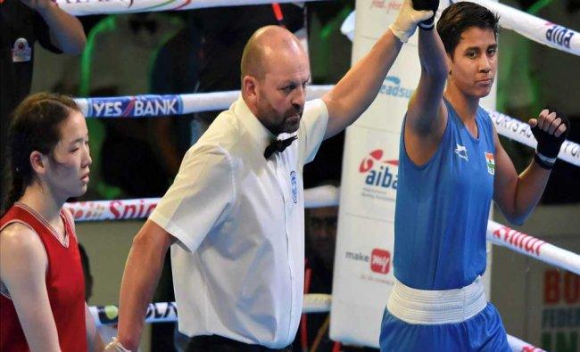 India\'s Shashi Chopra (Blue) is declared winner against Namuun Monkhor of Mongolia...