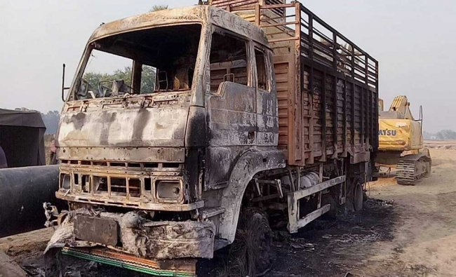 Truck that was set on fire by suspected Maoists in Gaya district, on Saturday...