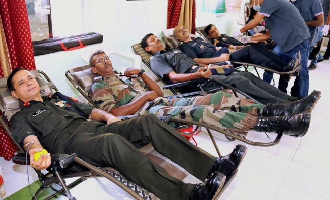Soldiers donating blood at 1 EME Centre, during Army -Voluntary Blood Donation Camp to help...