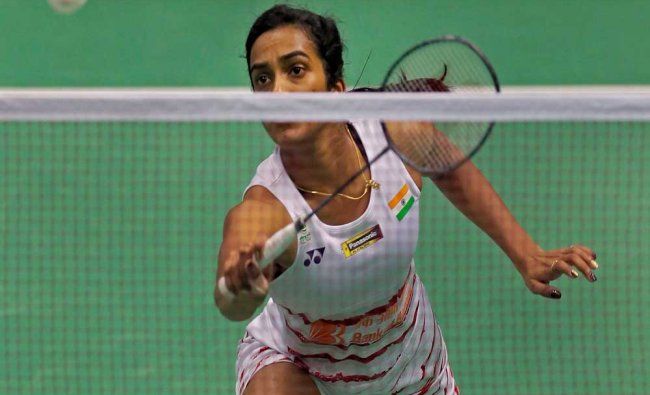 P.V. Sindhu of India returns a shot against Ratchanok Intanon of Thailand in the semi-final...