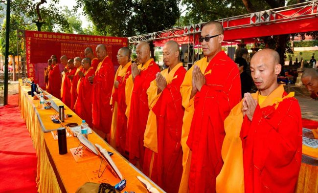 Buddhist monks of China offering special prayers under the holy Bodhi tree at Mahabodhi...