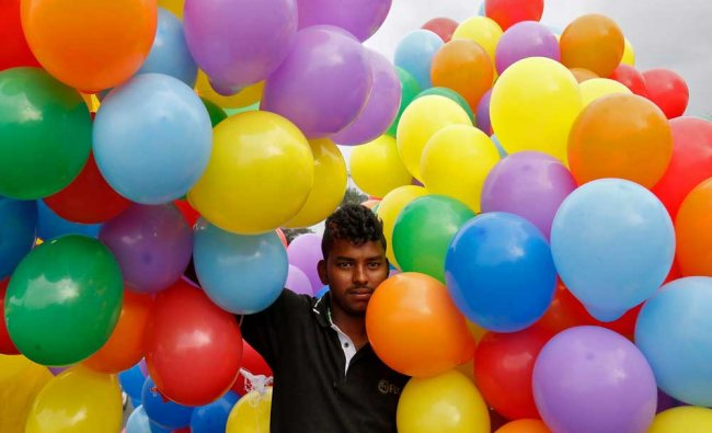 A man carrying balloons arrives at the 10th Namma Pride March, an event promoting gay...
