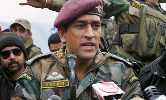 Former cricket captain and honorary Lt Col M S Dhoni speaks to media while being as the chief...