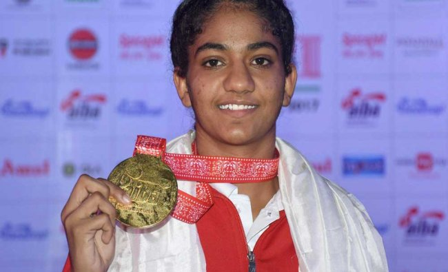 India\'s Nitu displays her gold medal after winning the final match of Womens Light Fly...
