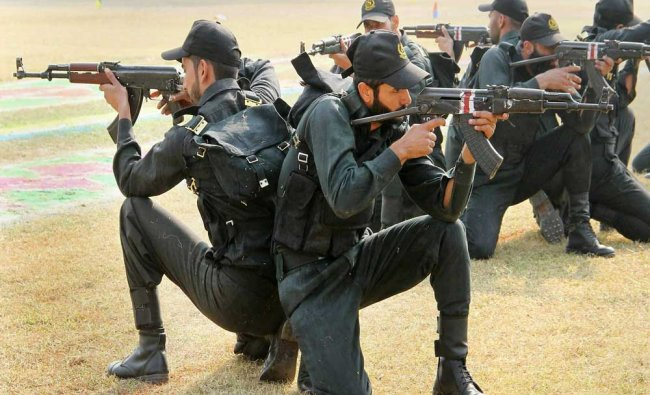 Police personnel perform a drill during the Attestation-cum-Passing Out Parade of 25th BRTC Batch..