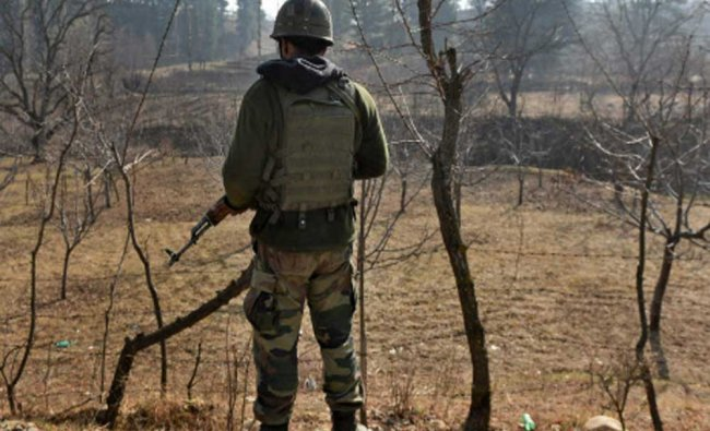 An army soldier stands guard during an encounter with the militants at Futlipora Pakharpora...