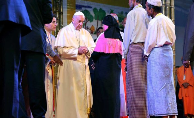 Pope Francis interacts with a Rohingya Muslim refugee at an interfaith peace meeting...