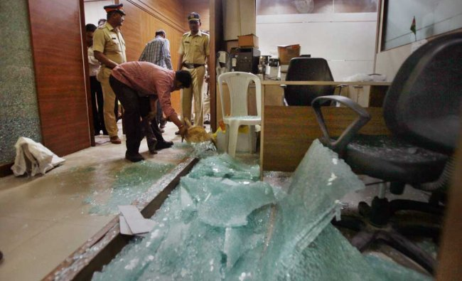 Police inspecting the Congress\' office in Mumbai...