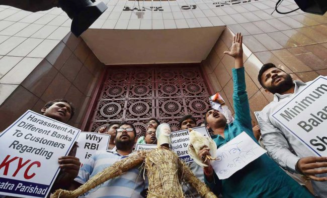 Activists of Chhatra Parishad take part in a protest against the Modi...