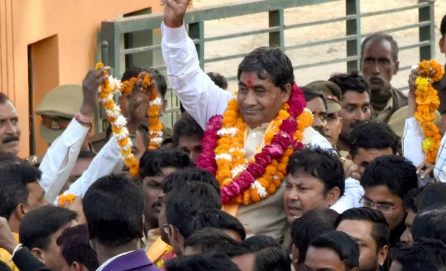 BJP candidate Vijay Arya Bandhu celebrates the partys victory...