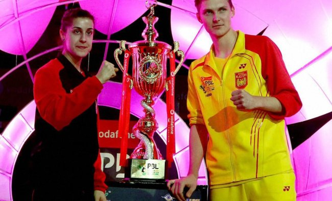 pain\'s Carolina Marin of Hyderabad Hunters and Denmark\'s badminton player Viktor Axelsen...