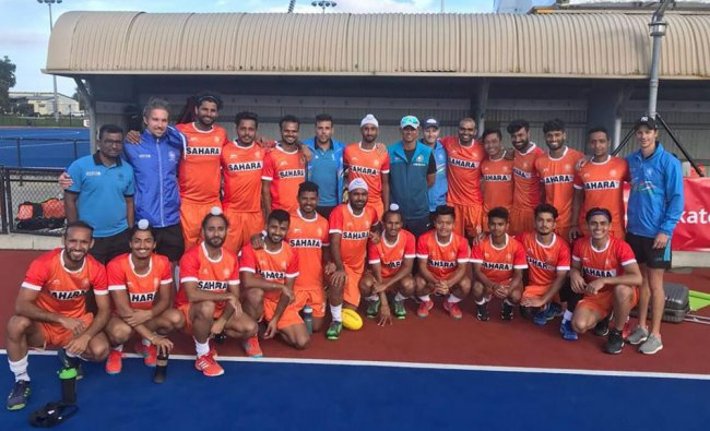 U-19 cricket team coach Rahul Dravid in a group photo with Indian hockey team players...