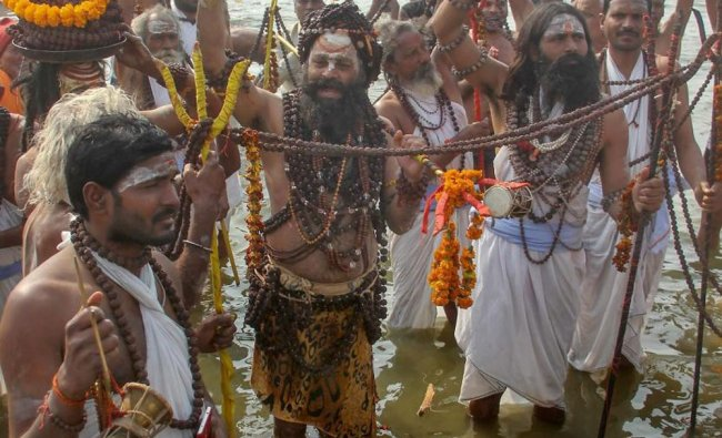 Mauni baba along with his followers arrives to take holy dip at Sangam on the occasion...