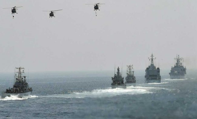 India and Japanese Coast Guard ships participate in a joint naval drill as part of the search...