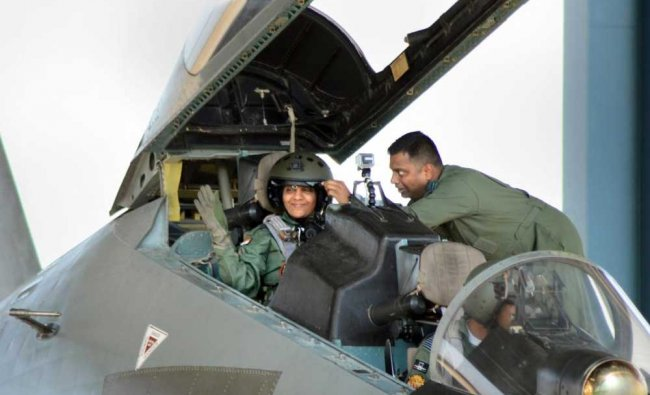 Defence Minister Nirmala Sitharaman waves from the cock-pit of IAF\'s Sukhoi-30 MKI plane...