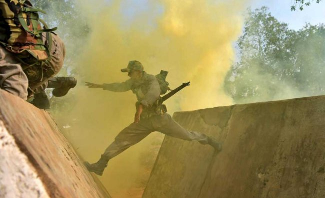 New recruits of Madras Engineer Group and Centre during a military training demonstration...