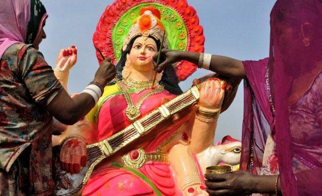 Artists paint an idol of Goddess Saraswati at a workshop in Amritsar on Thursday...
