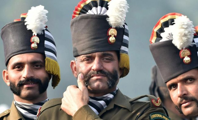 A contingent of Territorial Army wait during the Republic Day parade rehearsal at Rajpath...