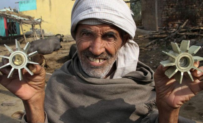 A villager displays a mortar shell allegedly fired on a residential area from the Pakistan...