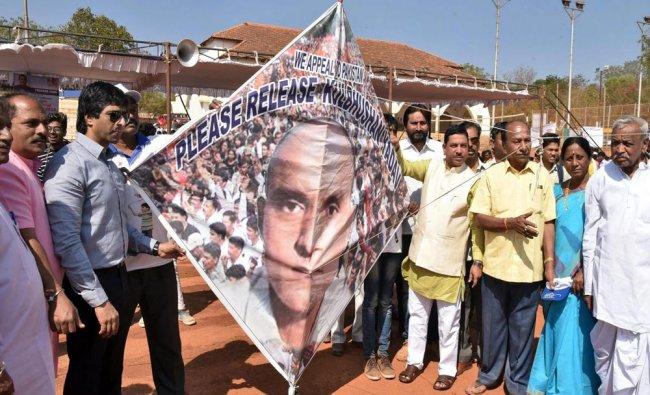 Kite-enthusiasts display a kite with an image of Kulbhushan Jadhav during International Kite...