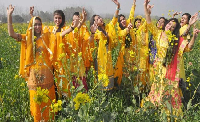 School students wear the customary yellow dress for Basant Panchami ...