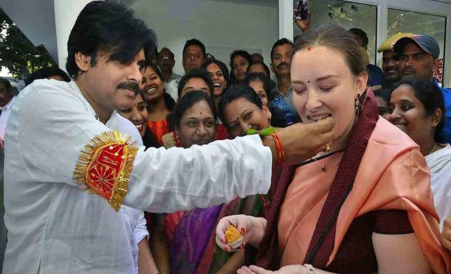 Jana Sena Party chief and actor Pawan Kalyan offers sweets to his wife Anna Lezhneva before...