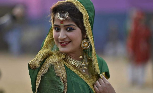 An artist of J & K tableau for the Republic Day parade, during a press preview in New Delhi...