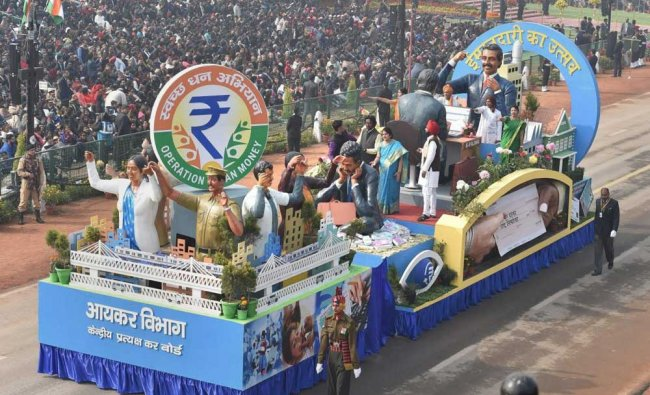 The Income Tax department tableau at the 69th Republic Day Parade at Rajpath in New Delhi on ...