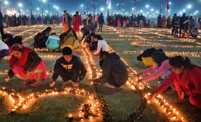 People take part in Deep Daan at Sangam during Magh mela in Allahabad on Saturday..