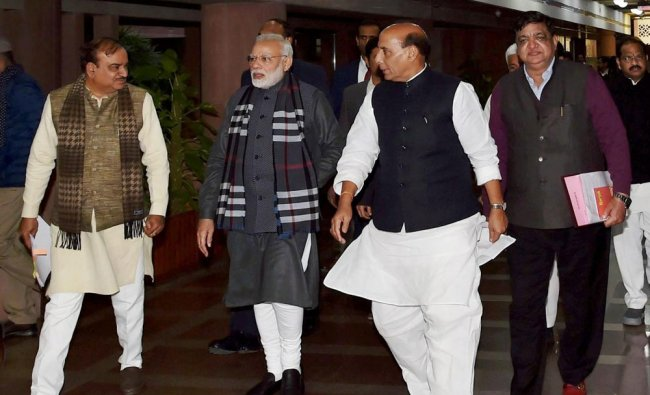 Prime Minister Narendra Modi with Parliamentary Affairs Minister Ananth Kumar and Home Minister ...