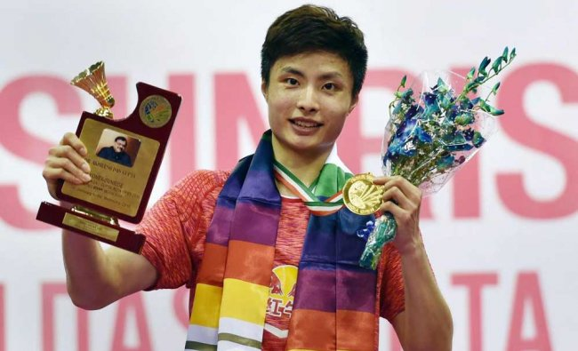 Shi Yuqi poses for a picture after winning India Open men\'s singles final...