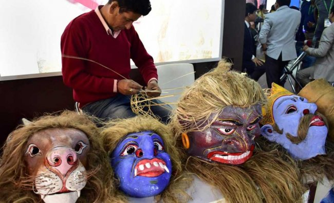 An artist puts on displays the traditional masks of Assam...