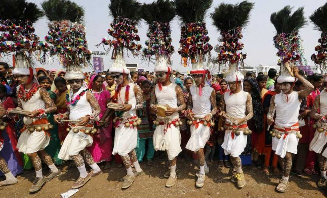 Members of Rathwa tribal community perform their traditional dance during Holi celebration at...